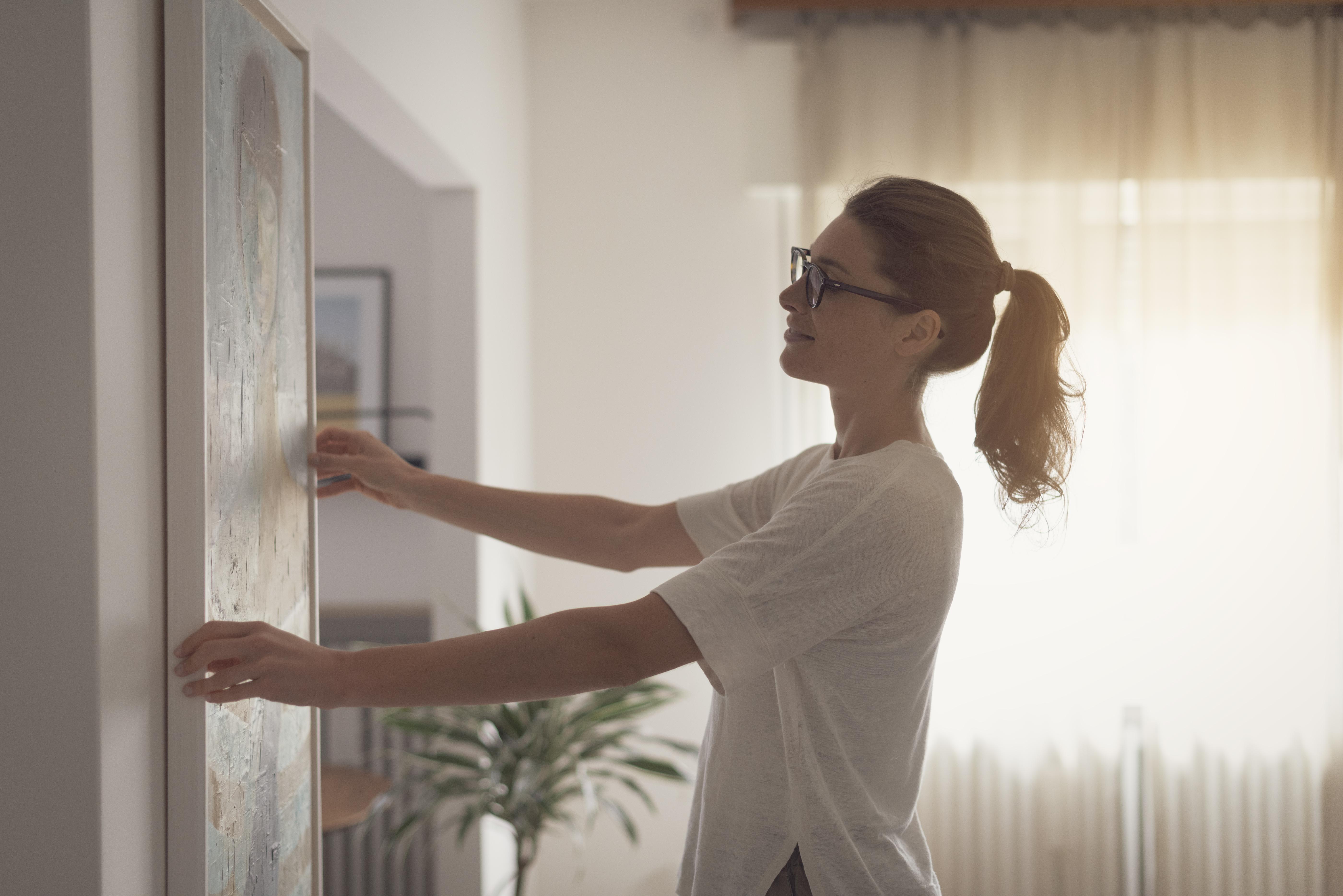 Woman hanging art